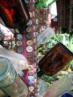 Bottle and bottle cap tree (use this in combo with old license plates to cover bottom of booth) Gypsy camper? World traveler, oscar?