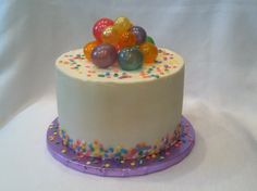 Confetti sprinkles and gelatin bubbles. All buttercream cake.
