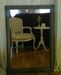 Interia from Troll hart. Old chair and table in a mirror with a frame of fake drift wood.