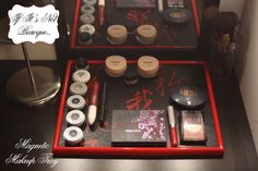 From the If It's Not Baroque blog - DIY Magnetic Makeup Tray; Supplies you'll need include a frame she used a 11x14 frame from the Dollar Store), Galvanized magnetic metal (Lowe's), magnets, Mod Podge, a paint brush, hot glue & glue gun, fabric of your choice, & your makeup.