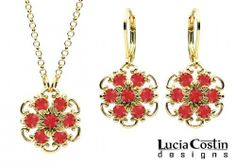 Lucia Costin 14K Yellow Gold over .925 Sterling Silver Pendant and Earrings Set with Twisted Lines and 6 Petal Middle Flowers Surrounded by Dots and Red Swarovski Crystals; Handmade in USA Lucia Costin. $105.00. Delicate floral design. Enriched with scarlet Swarovski crystals. Floral jewelry set by Lucia Costin. Unique and feminine, perfect to wear for special occasions and evenings. Produced delicately by hand, made in USA