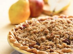 Apple, Pear, and Cranberry Pie - Take good old apple pie a step further with fresh pears and dried cranberries. The filling's tart sweetness it nicely offset by a crumbly brown-sugar-and-walnut topping. Dutch Apple Pie Topping, Cranberry Pie, Valeur Nutritive, Apple Pie Recipes, Fall Recipes, Yummy Recipes, Delicious Desserts, Yummy Food, Spiced Apples
