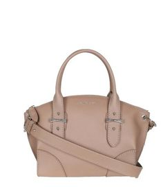 Notes Small Legend bag has a top curved zip, evolving into a wider body with crafted corners.