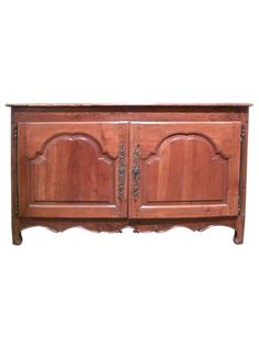 Well carved two door buffet of wide proportion, with two arched paneled doors, the feet shaped, vertical extensions of the rounded supports.   TheHighBoy   #highboystyle #antiquesmakeitbetter #antiques #vintage
