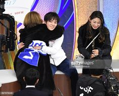 Shoma Uno hugs with his coach Machiko Yamada at the kiss and cry after competing in the Men's Singles Free Skating during day four of the 86th All Japan Figure Skating Championships at the Musashino...