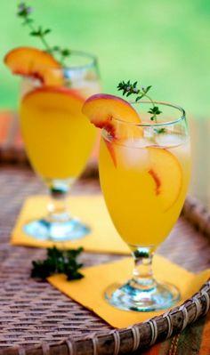 Peach Coolers | 1 oz fresh Peach Puree 1 1/2 oz fresh Orange Juice, 1 oz Simple Syrup, 5 oz Club Soda, 1 oz Gin & dash of peach bitters