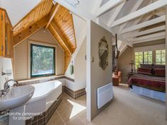 Painted knotty pine ceilings, bijou en suite in cosy corner of bedroom: Richmond Valley Road, Richmond, Tas 7025
