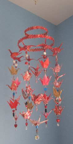 A double hoop covered in ribbon or fabric would be possible way to hang them.