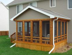 a small extension off this screened porch contains a captured ... - Closed In Patio Designs