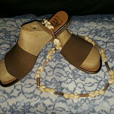 Brown metallic w/elastic uppers slides Brown slides with elastic uppers, small beads across the tops, NWT,  Size: 10M by AE  (American Eagle ) AE  Shoes Sandals