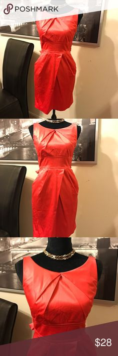 Beautiful coral dress with pockets & back bow tie This is a pre owned/ pre loved short coral dress. Teeze Me brand. Size 3. Has pockets and back bow tie. Check the images and feel free to ask questions. Also check out my closet for more 🌹 bundle and save 🌹 love reasonable offers. Teeze Me Dresses Mini