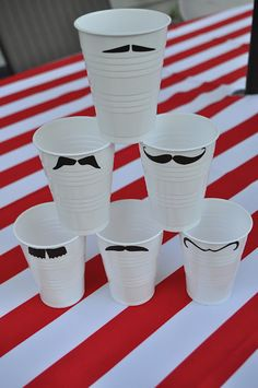 Mustaches on white cups