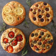 Foccacia bread 4 ways with a generous sprinkle of @jacobsensaltco on all of them  Used half all purpose flour and half whole wheat flour for the bread  Top left: lemon lemon zest thyme  Top right: grapes rosemary  Bottom left: cluster heirloom  garlic slices thyme  Bottom right: olives rosemary pimento peppers  Fun snack for a Sunday! . #buzzfeedfood  #buzzfeast #foodandwine #beautifulcuisines #baking #cookcl #todayfood #bobsredmill #feedfeed #spring #focaccia #bread #bareaders by thejamlab
