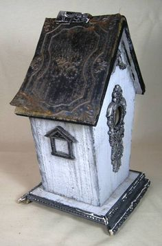 Um, if I had a birdhouse, it might be this one.  Prim Antique Soft Blue Gray Wood BirdHouse by ChicLaMaison on Etsy, $85.00