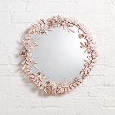 It's time to give your wall the crown it deserves.  You could start with our exclusive Flower Crown Wall Mirror.  This floral mirror features a gorgeous metal floral frame, complete with an easy-to-hang keyhole back. Nod exclusiveLight pink powder coated metal floral frameIncludes keyhole on back for easy hangingHanging hardware and instructions includedShow 'em what you're made ofIron frame with MDF backingGlass mirror.