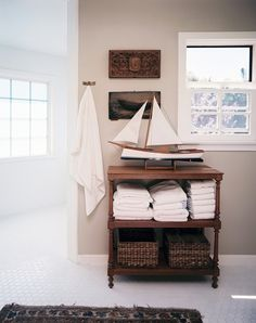 bench/table idea in corner for storing towels rather than putting under vanity