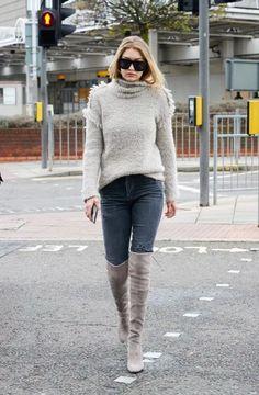 Gigi Hadid in grey Stuart Weitzman boots in London, England.