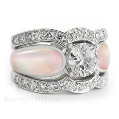"""Moonlit Petal - Radiance"" - A unique pink mother of pearl engagement ring with a 1 carat center diamond and fitted diamond wedding bands."