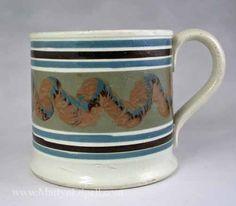 Mochaware Slip decorated pearlware mug with snail trail markings, circa 1850