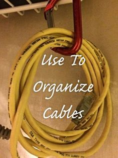 This trick keeps cords coiled, and lets them hang under a shelf — creating space you didn't even know you had.