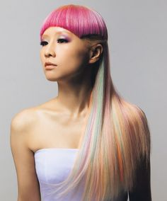Long/combination cut with side fade. multi-colored pastel hair. more pastels added for additional vibrancy. products; color extend shampoo & conditioner, align 12. rebook 4 weeks for a fade trim and color touch up.