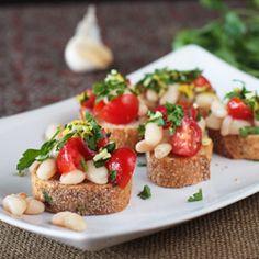 White bean and tomato bruschetta with gremolata. A great vegan app!