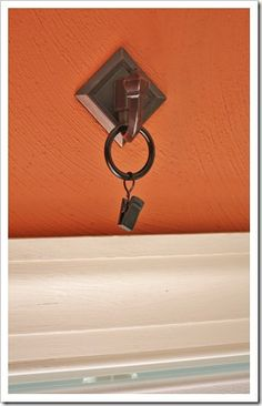 3M hook from Home Depot and curtain ring from Target--perfect way to hang curtains sans wall damage.