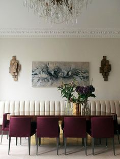 Dining Room - Plum purple wrap dining chairs + white leather banquette add to the sleek dining space.