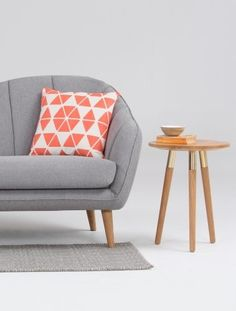 The geometric Coral Trio Cushion, sitting pretty on the Pebble Grey Geddes sofa. Add the Range Side Table in Oak and Copper for effortless style. | MADE.COM