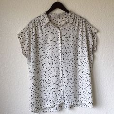 Ann Taylor LOFT Button Down Blouse Ann Taylor Loft Button Down Blouse- Dotted Black and Off White Short Sleeve Top. Size large. Great condition, one thread is slightly unaligned as shown in the photo. LOFT Tops Button Down Shirts