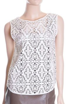 Color: White Size: Small, Medium, Large Product Detail +Tank top with crochet lace inspired laser cut faux leather in the front +Chiffon contrast back +Key hole with button back closure +Binding finis