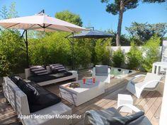 La terrasse du bas avec son jacuzzi et sa cuisine d'été