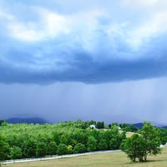 A summer rain storm in the Blue Ridge Mountains of South Carolina as seen from The Red Horse Inn terrace.