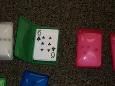 Travel soap containers for holding sets of cards.