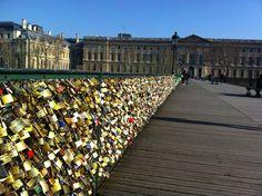A bridge covered with padlocks