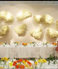 Floral hearts on wall - from a contemporary styled dinner in Italy.