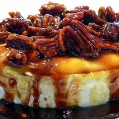 Baked Brie With Kahlua and Pecans Recipe: 3/4 cup chopped pecans 1/4 cup Kahlua 3 tablespoons brown sugar 1 (14 ounce) brie cheese Directions: bake at 350 until the topping is bubbly.