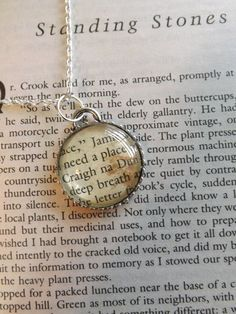 Outlander by Diana Gabaldon...necklace made from page of book! I want this! :)