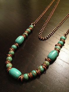 I LOVE the jump ring spacers!........  Turquoise Beads and Copper Chain Long Necklace by TreesandDreams,