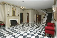 A popular paint scheme used during the 18th century was the classic black and white checkerboard design. This is a beautiful example of this style, fauxed to look like marble, from the elegant foyer of Gracie Mansion, the official residence of the New York City ma