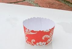 How to make you own cupcake wrappers, great for school, weddings, parties etc! Cheap too. Great with any party decor, just buy scrap booking paper.