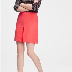 """Pleat front skirt Beautiful shade of coral with a hidden back zipper. Lined. 18"""" long Ann Taylor Skirts"""
