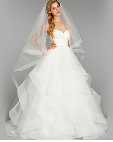 Princess Sweetheart Ruffled Organza Wedding Dress. This wedding dress has a pleated sweetheart neckline to emphasize the bust, and flares into a princess silhouette to make you feel like royalty on your wedding day. The organza draping on the skirt is ruffled to add a unique design to this gorgeous dress. You will truly look and feel stunning on your wedding day.