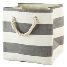Stripes Around the Cube Bin (Grey)  | The Land of Nod Place on floor next to bookcase fill with toys.