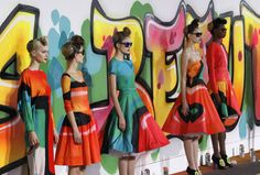 Models wear creations from designer Manish Arora as part of the Fall-Winter, ready-to-wear 2013 fashion collection, during Paris Fashion week, Thursday, March 1, 2012. (AP Photo/Christophe Ena)