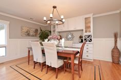 Dining room with built-in buffet and beautiful wainscoting.