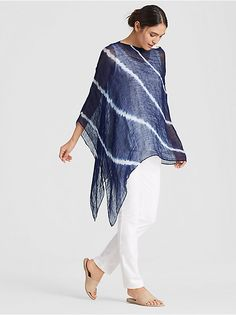 A sheer poncho with refined texture, dyed with contrasting lines of color. Designed to drape diagonally on the body. Shibori, Minimalist Fashion Women, Poncho Tops, Indigo, Denim And Lace, Estilo Boho, Elegant Outfit, Swimwear Fashion, Eileen Fisher