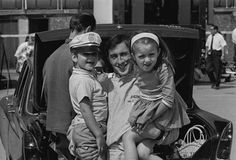 1965 A crumpled-looking but smiley Jackie Stewart babysits Damon and Brigitte for Graham Hill.