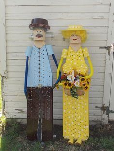 Mr. & Mrs. Irons made from ironing boards, coffee cans, jello molds etc. garden sculptures