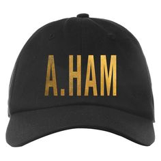 This flat brim, adjustable snap back cap is embroidered with A. HAM on the front and Hamilton An American Musical on the back.